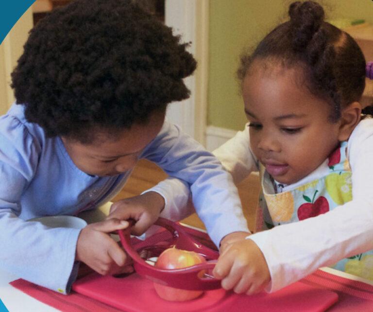 children sharing an apple